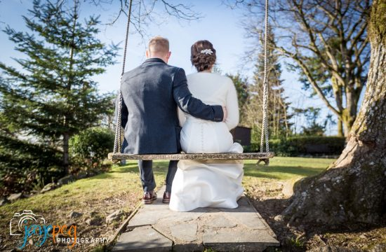 A wedding photograph of the bride and groom on the tree swing at Broadoaks Country House Hotel taken by wedding photographer Jaye-Peg Photography
