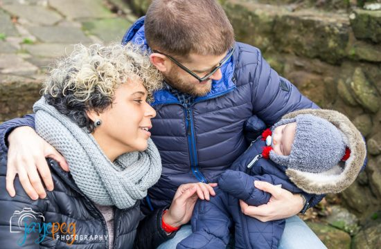 parents and baby in the grounds of egremont castle