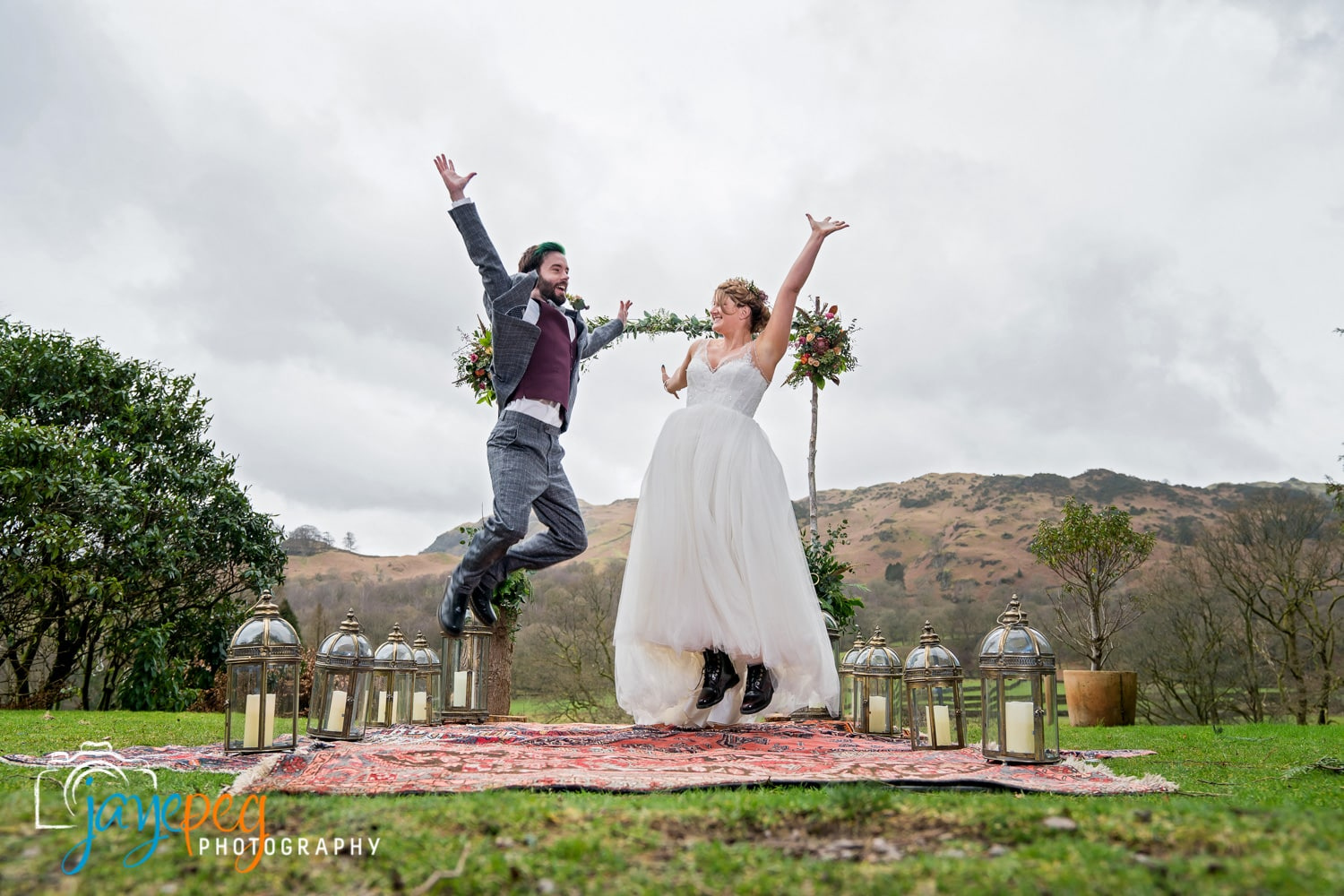 groom and bride jumping for joy