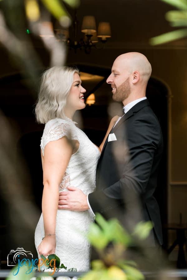 bride and groom portrait in an open doorway