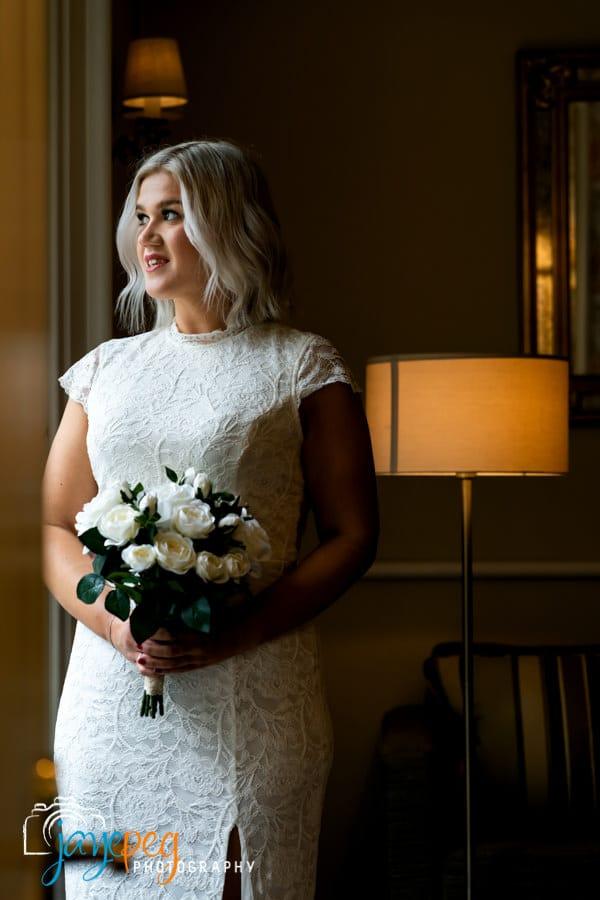 bride portrait lit through an open doorway