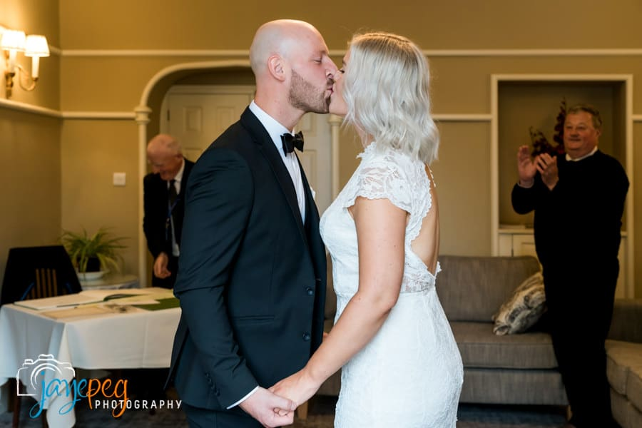 bride and grooms first kiss after their micro wedding ceremony