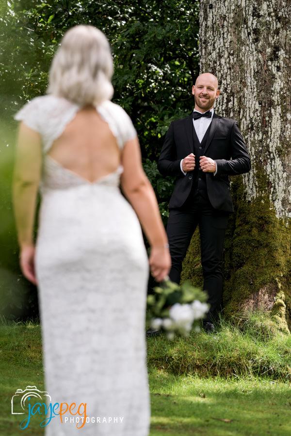 groom looks lovingly at his bride