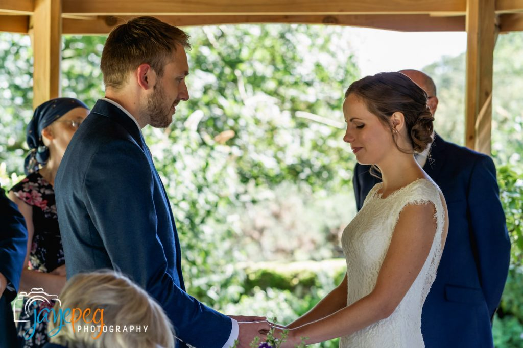 a bride and groom holding hands during their elopement wedding