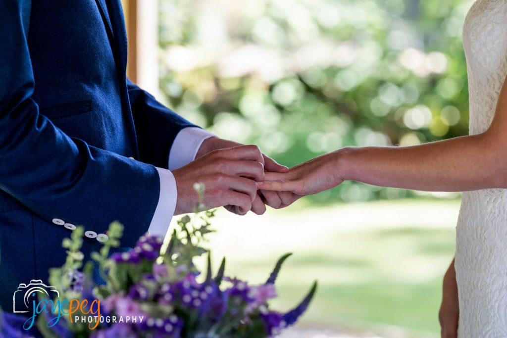 exchanging rings during a micro wedding