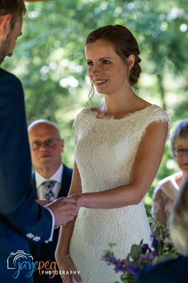 a bride looks at her groom
