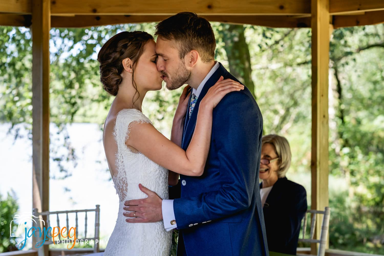 a bride and groom share their first kiss together