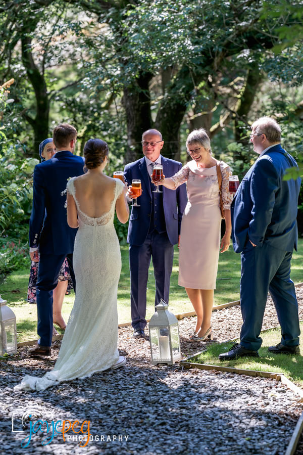 parents celebrate with a toast to the bride and groom