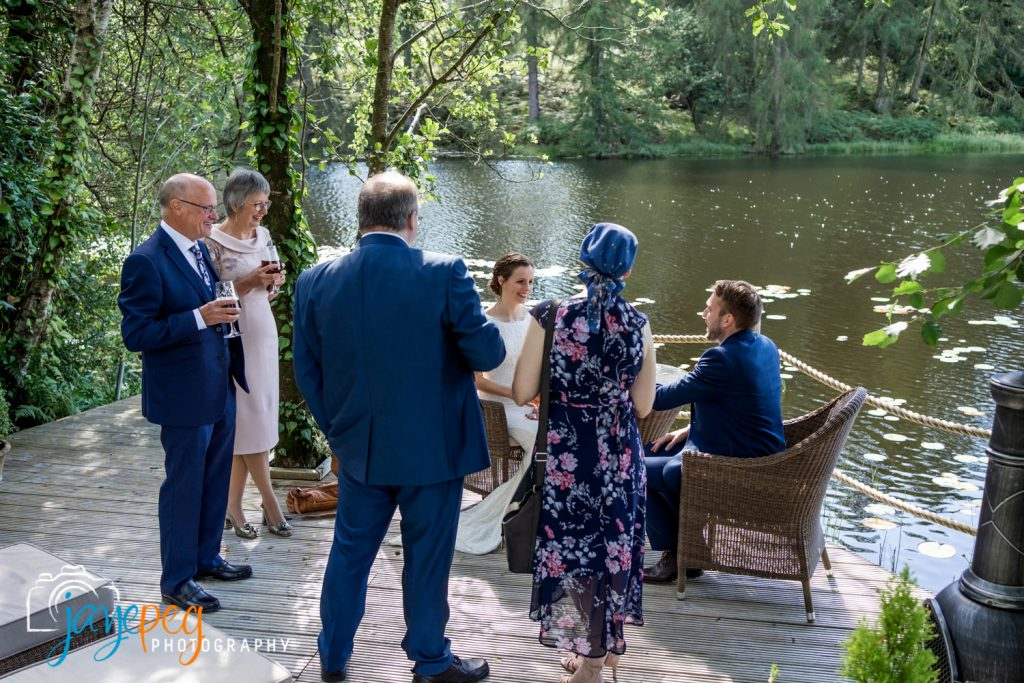 a micro wedding party at the boathouse at gilpin lake house