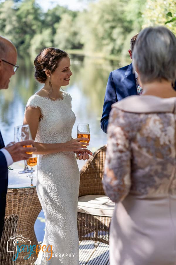 a bride talks to her guests