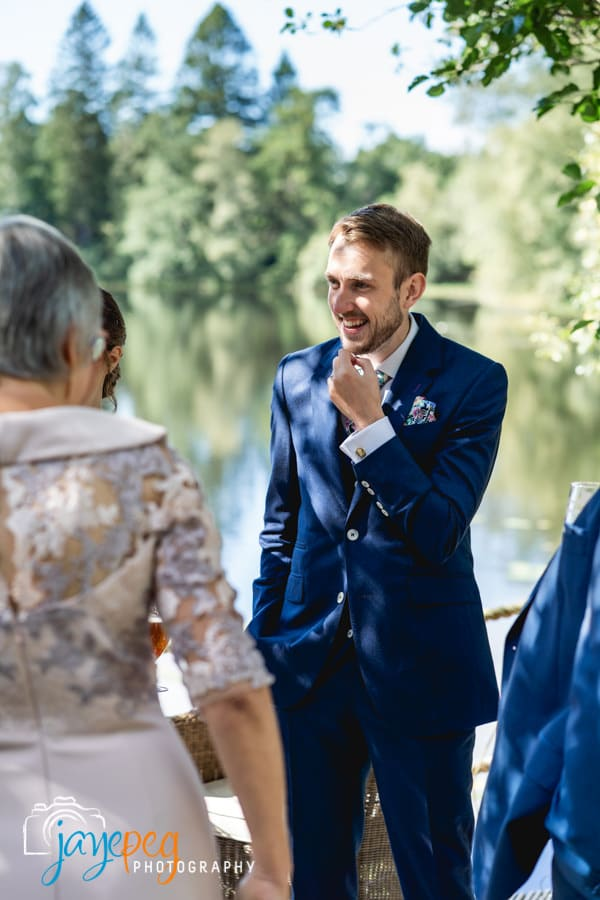 a groom talks to his guests