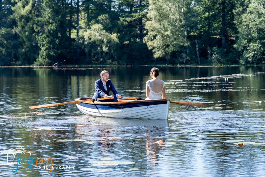 bride and groom in a rowing boat on knife tarn