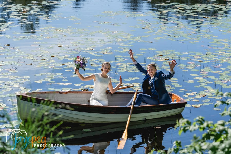 bride and groom wave at their parents