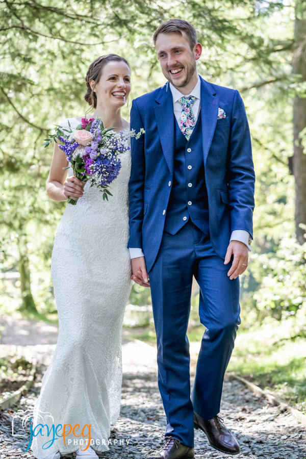 a bride and groom after their micro elopement wedding at gilpin lake house