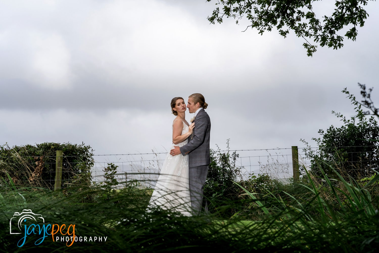 bride and groom portrait in the ground of low hall the lakes