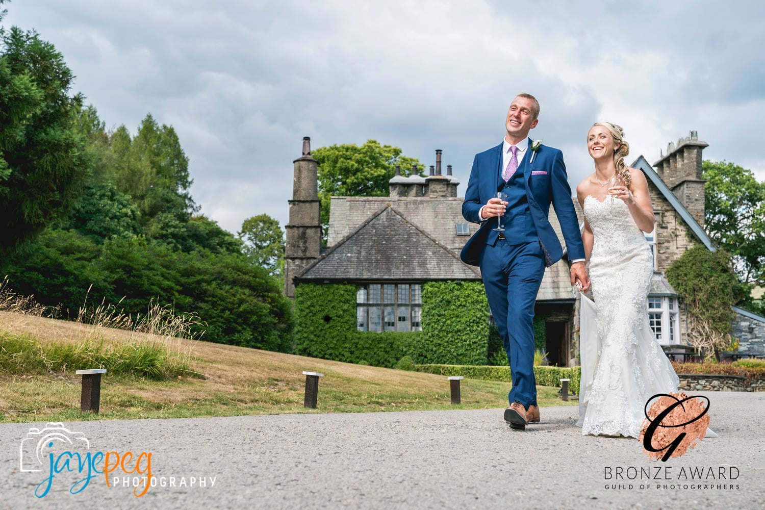 bride and groom walking down the driveway at broadoaks country house hotel in trout beck bridge near windermere