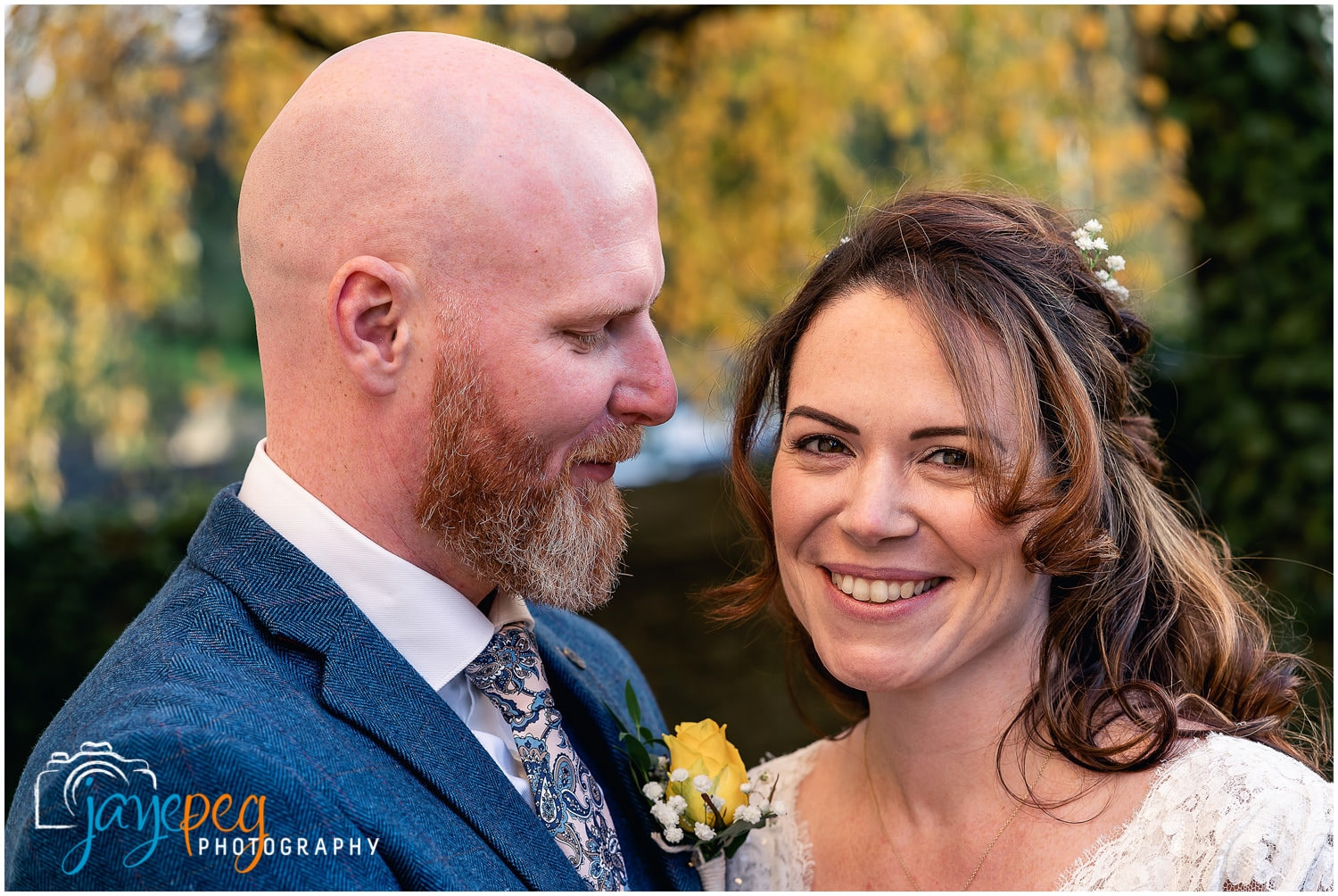 portrait of a bride and groom outside cockermouth town hall