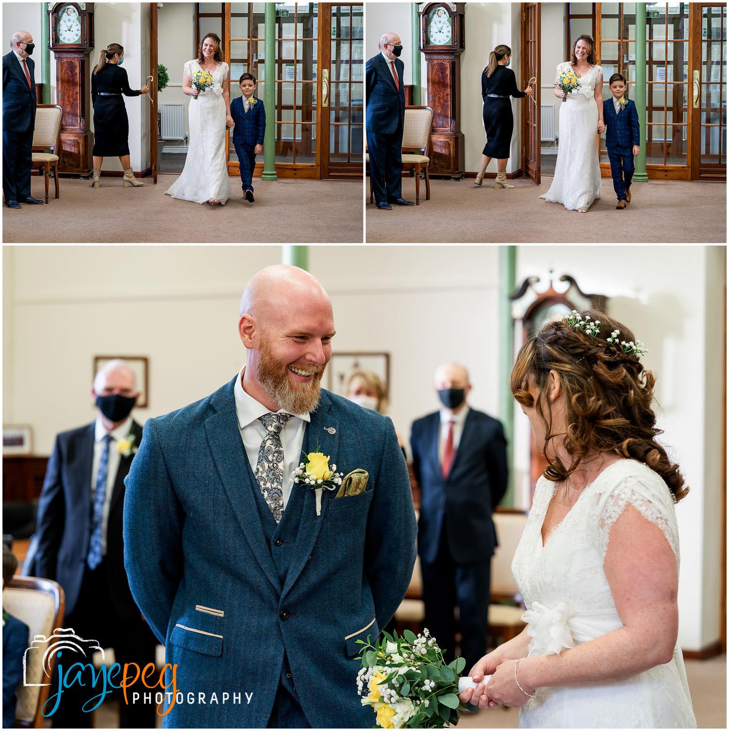 A bride walks down the aisle at Cockermouth Town Hall